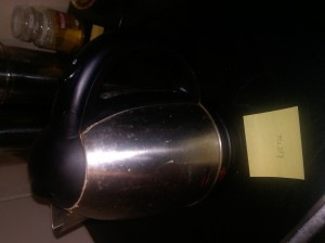 Kettle, with Coffee in the background. Image by The Naughty Corner